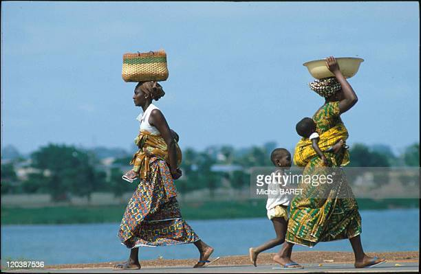 Yamoussoukro, Ivoiry Coast in May, 1982 - Two women coming back from market.