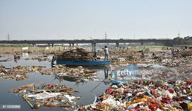 Yamuna River polluted after the material of Durga Puja immersed in the river near ISBT in New Delhi