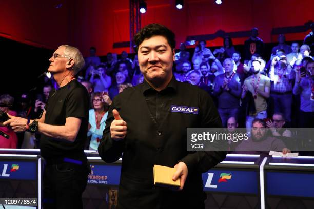 Yan Bingtao of China thumbs up after the final match against Judd Trump of England on day seven of 2020 Coral Players Championship at Southport...