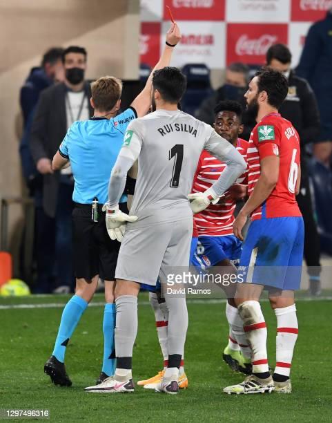 Yan Brice of Granada receives a red card from referee Valentin Gomez during the La Liga Santader match between Villarreal CF and Granada CF at...