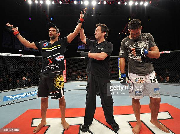Yan Cabral celebrates after defeating David Mitchell in their welterweight bout during the UFC Fight Night event at the Ginasio Jose Correa on...