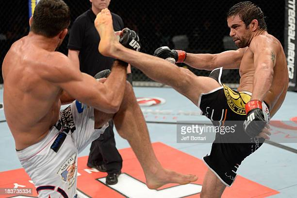 Yan Cabral kicks David Mitchell in their welterweight bout during the UFC Fight Night event at the Ginasio Jose Correa on October 9, 2013 in Barueri,...
