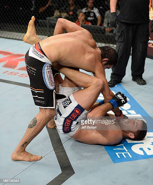 Yan Cabral punches David Mitchell in their welterweight bout during the UFC Fight Night event at the Ginasio Jose Correa on October 9, 2013 in...