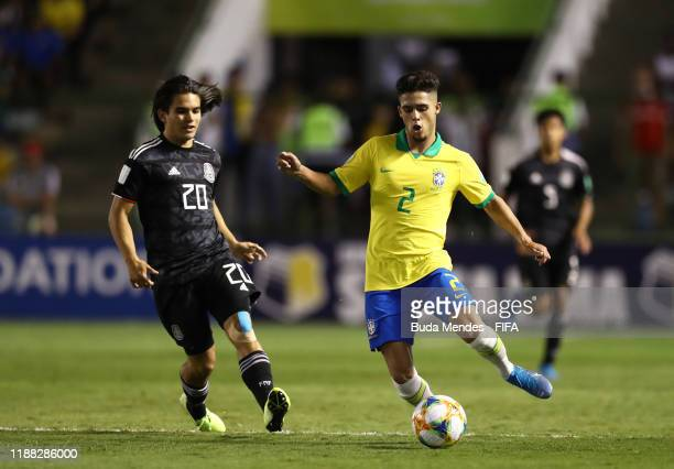 Yan Couto of Brazil looks to break past Bruce ElMesmari of Mexico during the Final of the FIFA U17 World Cup Brazil 2019 between Mexico and Brazil at...