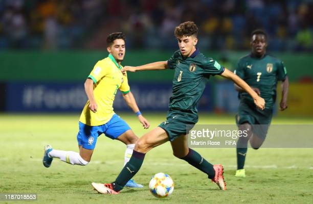 Yan Couto of Brazil looks to break past Matteo Ruggeri of Italy during the FIFA U17 World Cup Quarter Final match between Italy and Brazil at the...