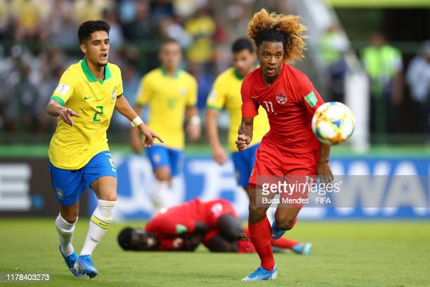 Yan Couto of Brazil struggles for the ball with Jayden Nelson of Canada during the FIFA U17 Men's World Cup Brazil 2019 group A match between Brazil...