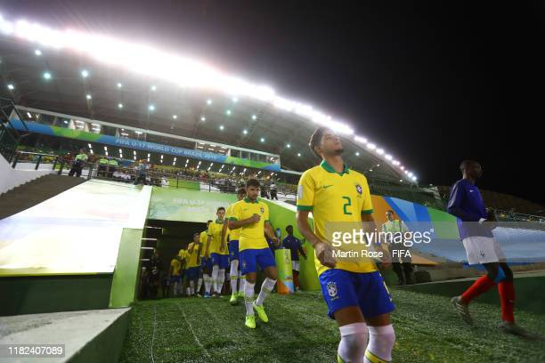 Yan Couto of Brazil walks out to the pitch with teammates prior to the FIFA U17 World Cup Brazil 2019 semifinal match between France and Brazil at...