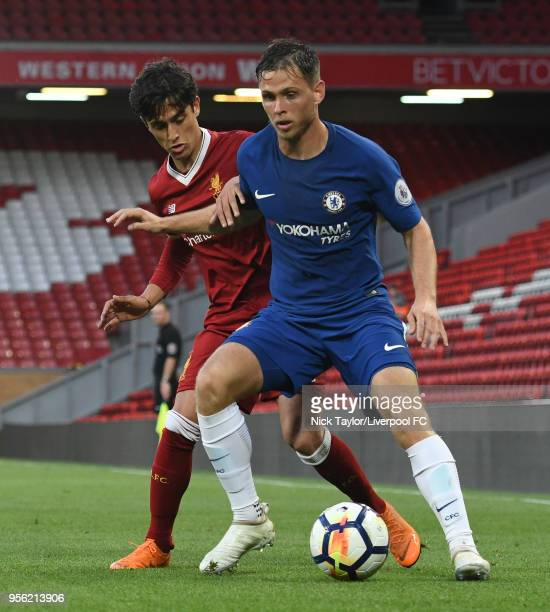 Yan Dhanda of Liverpool and Charlie Colkett of Chelsea in action during the Liverpool v Chelsea PL2 game at Anfield on May 8 2018 in Liverpool England