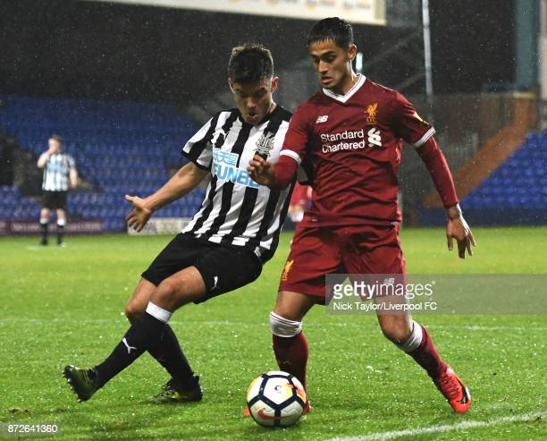 Yan Dhanda of Liverpool and Dam Ward of Newcastle United in action during the Premier League International Cup match between Liverpool U23 and...