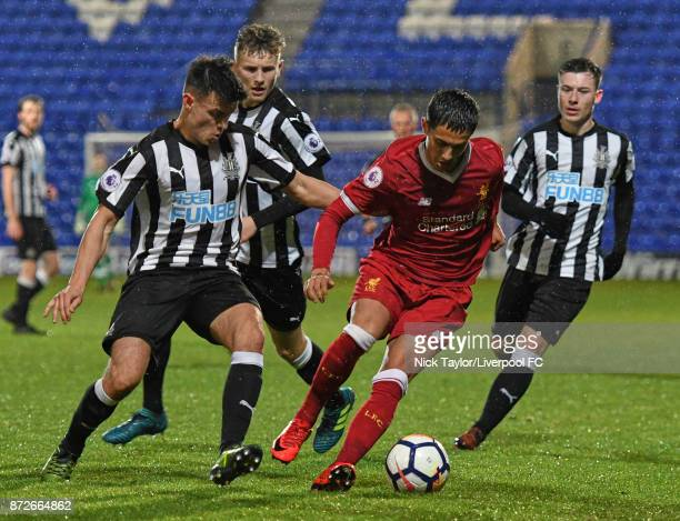 Yan Dhanda of Liverpool and Dan Ward and Callum Roberts of Newcastle United in action during the Liverpool U23 v Newcastle United U23 Premier League...