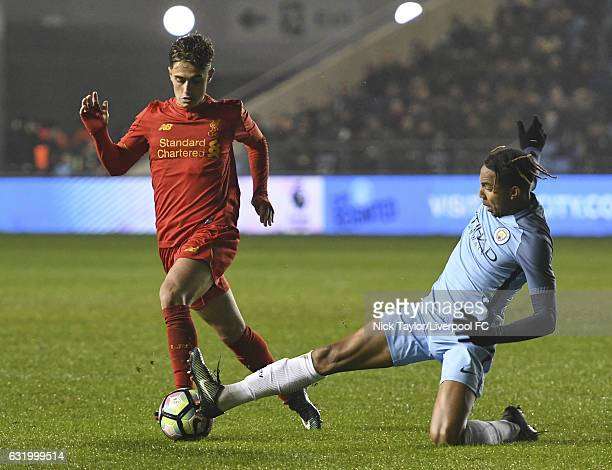 Yan Dhanda of Liverpool and Demeaco Duhaney of Manchester City in action during the Manchester City v Liverpool FA Youth Cup game at Etihad Campus on...