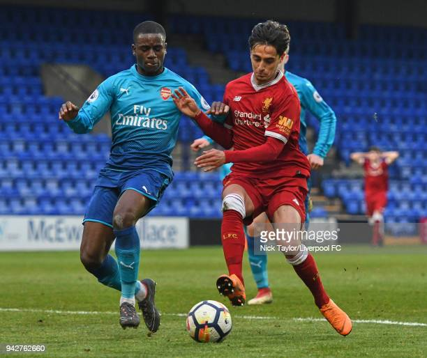 Yan Dhanda of Liverpool and Jordi OseiTutu of Arsenal in action during the Liverpool U23 v Arsenal U23 game at Prenton Park on April 6 2018 in...