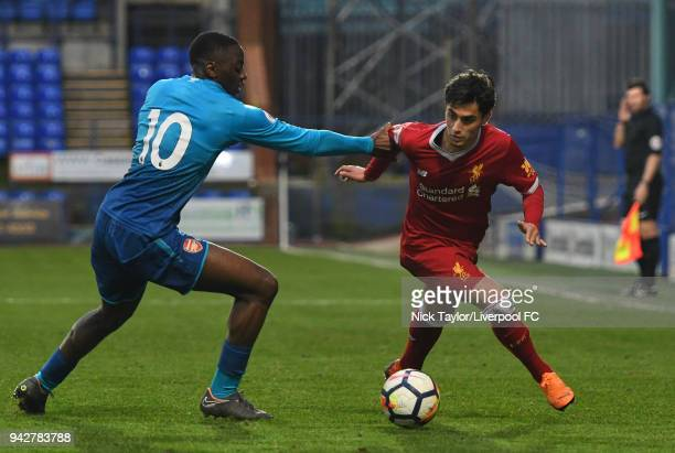 Yan Dhanda of Liverpool and Josh Da Silva of Arsenal in action during the Liverpool U23 v Arsenal U23 game at Prenton Park on April 6 2018 in...