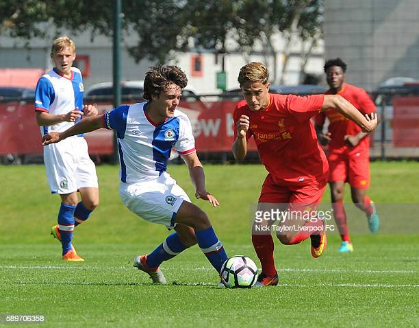 Yan Dhanda of Liverpool and Stefan Mols of Blackburn Rovers in action during the Liverpool v Blackburn U18 game at the Kirkby Academy on August 15...