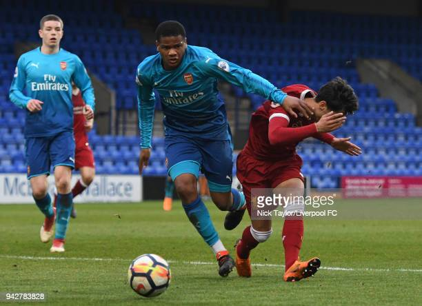 Yan Dhanda of Liverpool and Vontae DaleyCampbell of Arsenal in action during the Liverpool U23 v Arsenal U23 game at Prenton Park on April 6 2018 in...