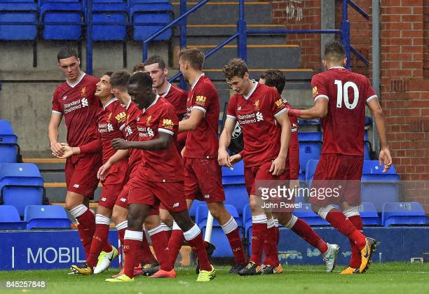 OUT Yan Dhanda of Liverpool celabrates scoring the winning goal with his team mates during the game at Prenton Park on September 10 2017 in...