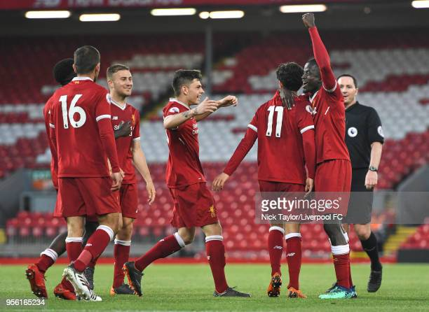 Yan Dhanda of Liverpool celebrates his second and Liverpool's fifth goal of the game with his team mates Bobby Adekanye Juanma Garcia Herbie Kane...