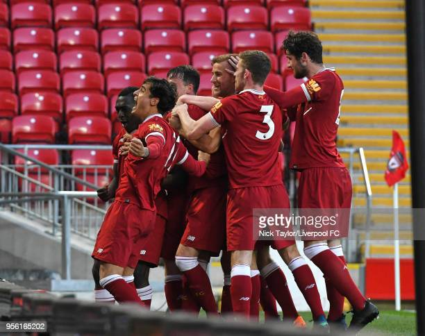 Yan Dhanda of Liverpool celebrates scoring Liverpool's third goal from the penalty spot with team mates during the Premier League 2 match between...