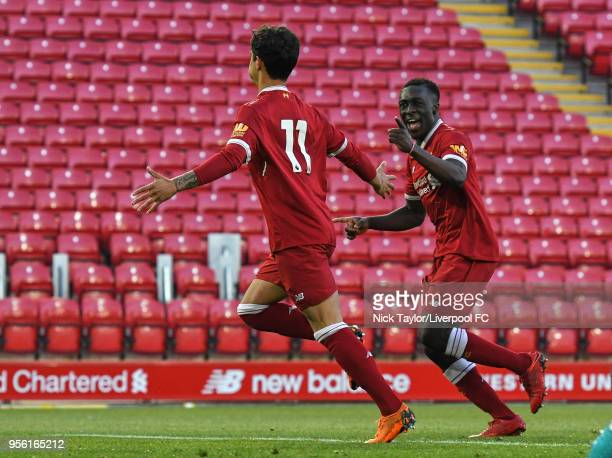 Yan Dhanda of Liverpool celebrates scoring Liverpool's third goal from the penalty spot with team mate Bobby Adekanye during the Premier League 2...