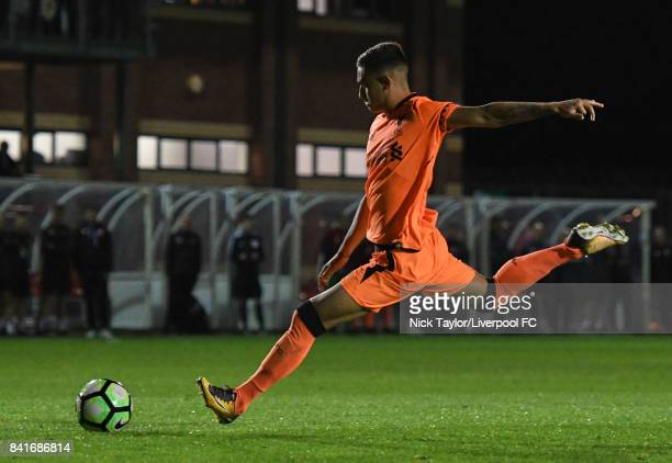 Yan Dhanda of Liverpool scores his penalty in the shootout during the Molson Coors Senior Cup Final at The County Ground on September 1 2017 in...