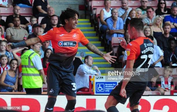 Yan Dhanda of Swansea City celebrates scoring his side's second goal with team mate Connor Roberts during the Sky Bet Championship match between...
