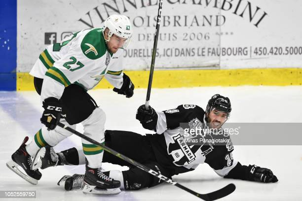 Yan Dion of the ValdOr Foreurs takes down Joël Teasdale of the BlainvilleBoisbriand Armada during the QMJHL game at Centre d'Excellence Sports...