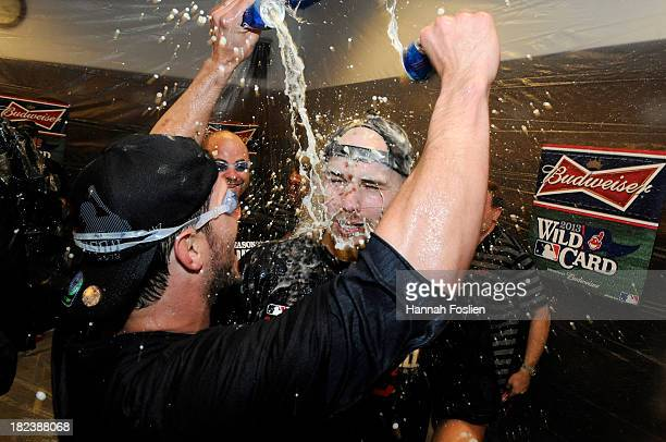 Yan Gomes and Justin Masterson of the Cleveland Indians celebrate with champagne after a win of the game against the Minnesota Twins on September 29...