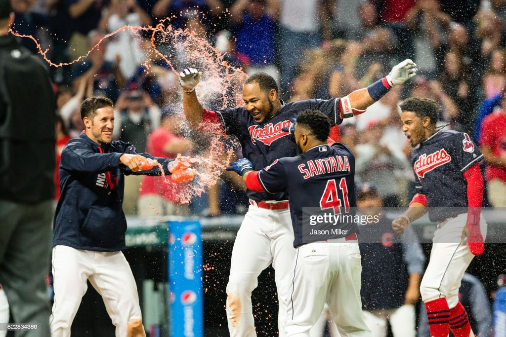 Yan Gomes #7, Carlos Santana #41 and Francisco Lindor #12 of the Cleveland Indians celebrate with Edwin Encarnacion #10 after Encarnacion hit a walk-off grand slam home run to defeat the Los Angeles Angels of Anaheim in the eleventh inning at Progressive Field on July 25, 2017 in Cleveland, Ohio. The Indians defeated the Angels 11-7.