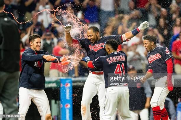 Yan Gomes Carlos Santana and Francisco Lindor of the Cleveland Indians celebrate with Edwin Encarnacion after Encarnacion hit a walkoff grand slam...
