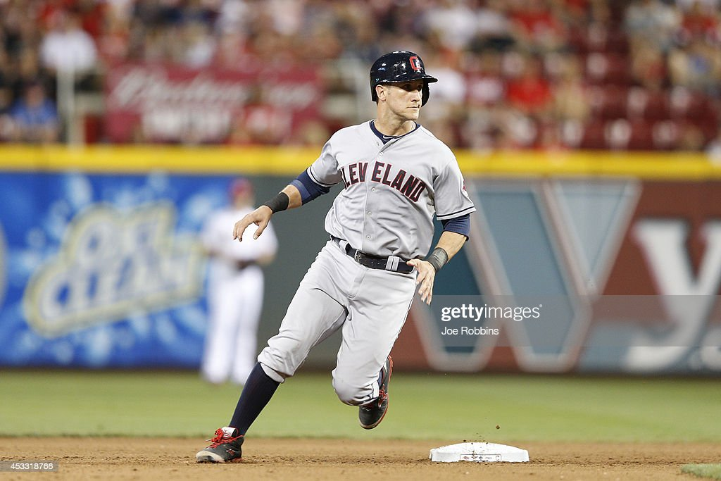 Yan Gomes #10 of the Cleveland Indians advances to second base after a wild pitch in the seventh inning of the game against the Cincinnati Reds at Great American Ball Park on August 7, 2014 in Cincinnati, Ohio. The Reds won 4-0.