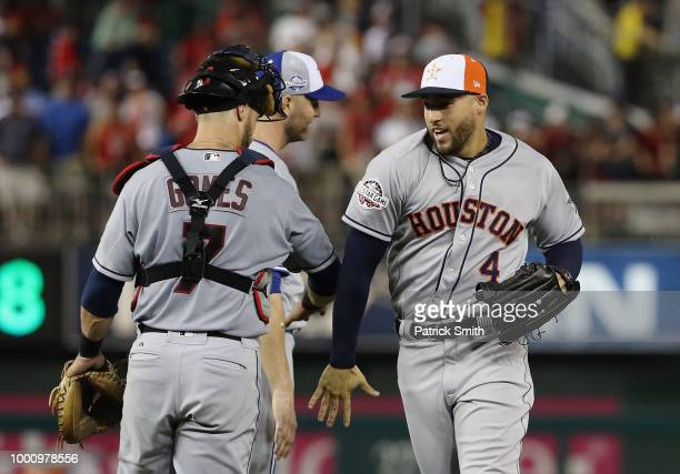 Yan Gomes of the Cleveland Indians and the American League and George Springer of the Houston Astros and the American League celebrate after...