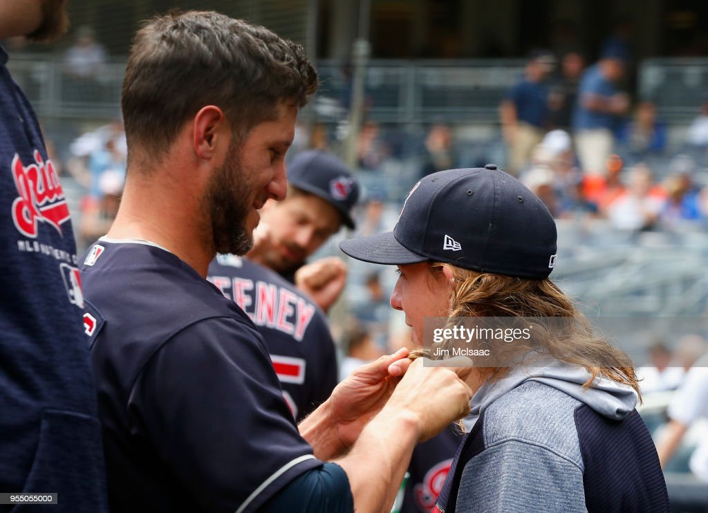 Yan Gomes #7 (L) of the Cleveland Indians braids the hair of theammate Mike Clevinger #52 prior to the start of a game against the New York Yankees at Yankee Stadium on May 5, 2018 in the Bronx borough of New York City.