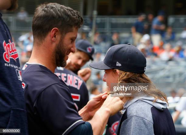 Yan Gomes of the Cleveland Indians braids the hair of theammate Mike Clevinger prior to the start of a game against the New York Yankees at Yankee...