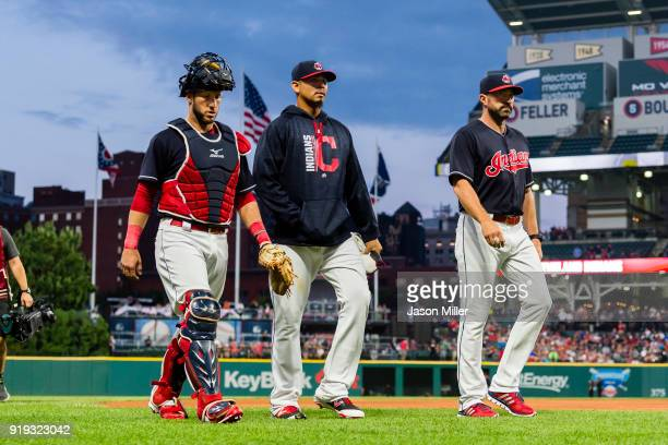 Yan Gomes of the Cleveland Indians Carlos Carrasco and Mickey Callaway of the Cleveland Indians walk onto the field prior to the game against the...