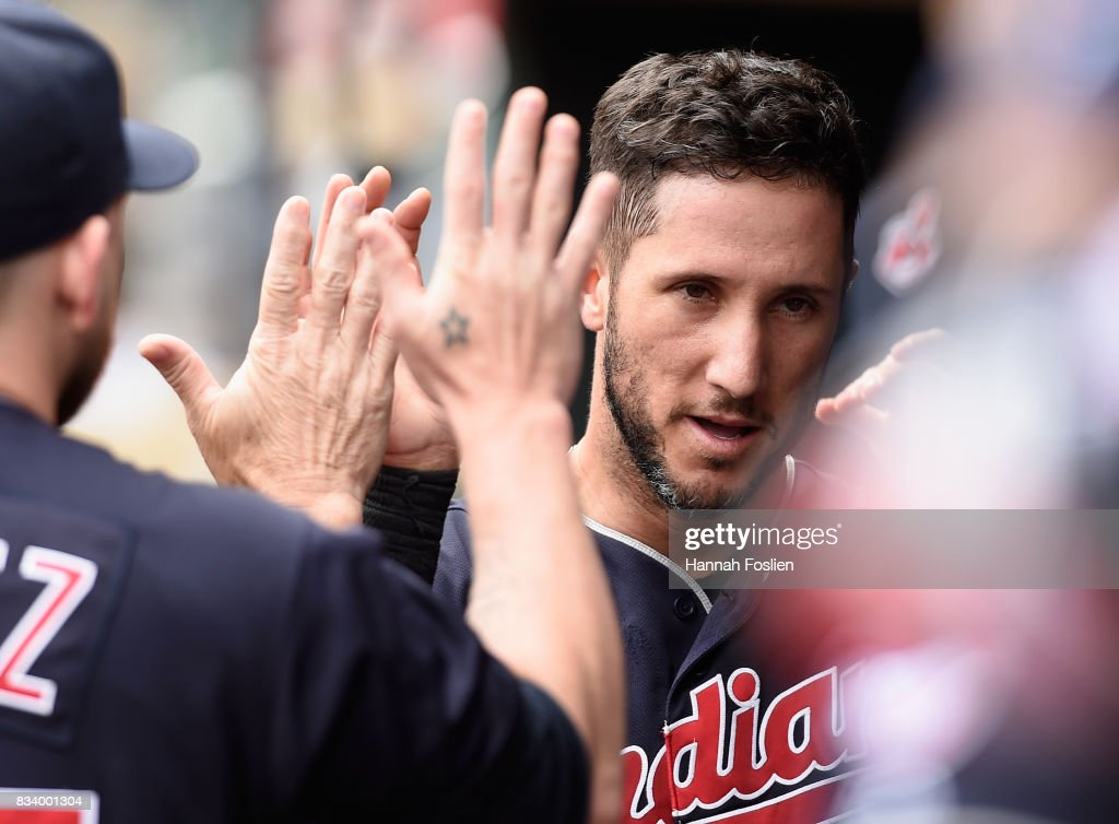 Yan Gomes #7 of the Cleveland Indians celebrates scoring a run against the Minnesota Twins during the second inning in game one of a doubleheader on August 17, 2017 at Target Field in Minneapolis, Minnesota. The Indians defeated the Twins 9-3.