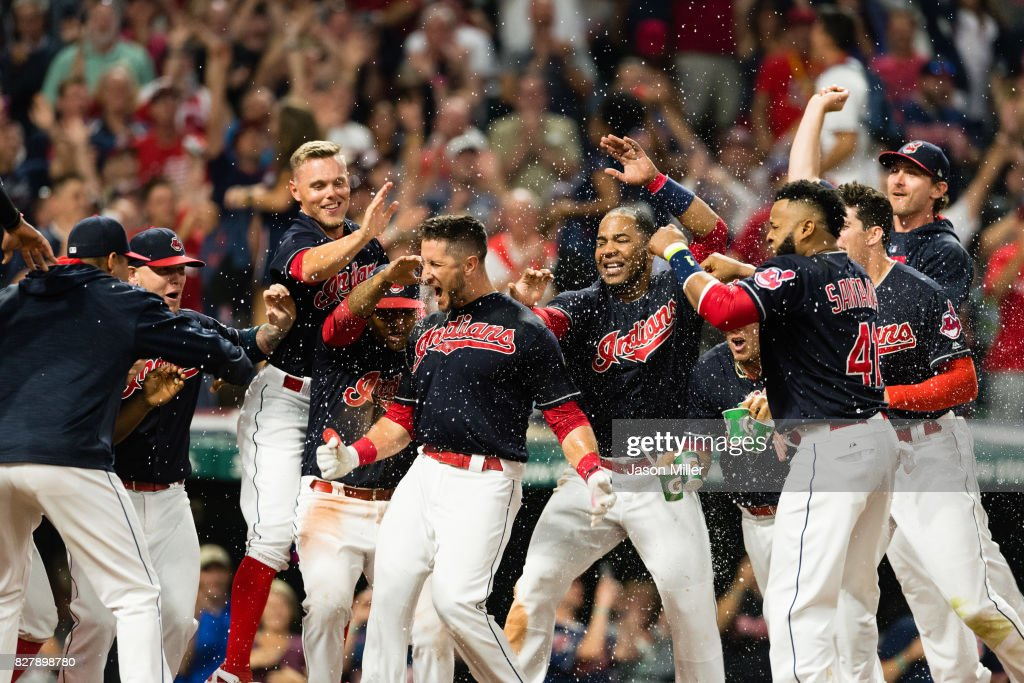 Yan Gomes #7 of the Cleveland Indians celebrates with his teammates after hitting a walk-off three run home run against the Colorado Rockies at Progressive Field on August 8, 2017 in Cleveland, Ohio. The Indians defeated the Rockies 4-1.