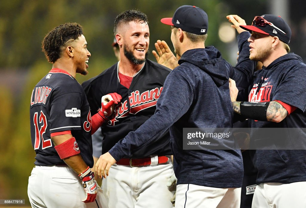 Yan Gomes #7 of the Cleveland Indians celebrates with teammates after he hit a an RBI single scoring Austin Jackson #26 to win the game 9 to 8 in the 13th inning during game two of the American League Division Series at Progressive Field on October 6, 2017 in Cleveland, Ohio.