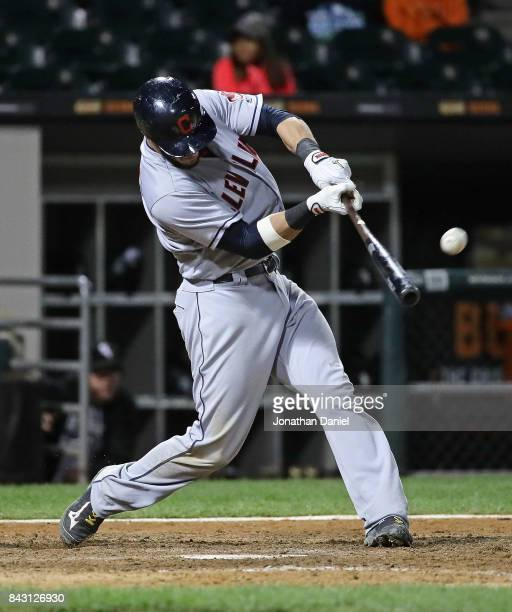 Yan Gomes of the Cleveland Indians hits a three run home run in the 9th inning against the Chicago White Sox at Guaranteed Rate Field on September 5...
