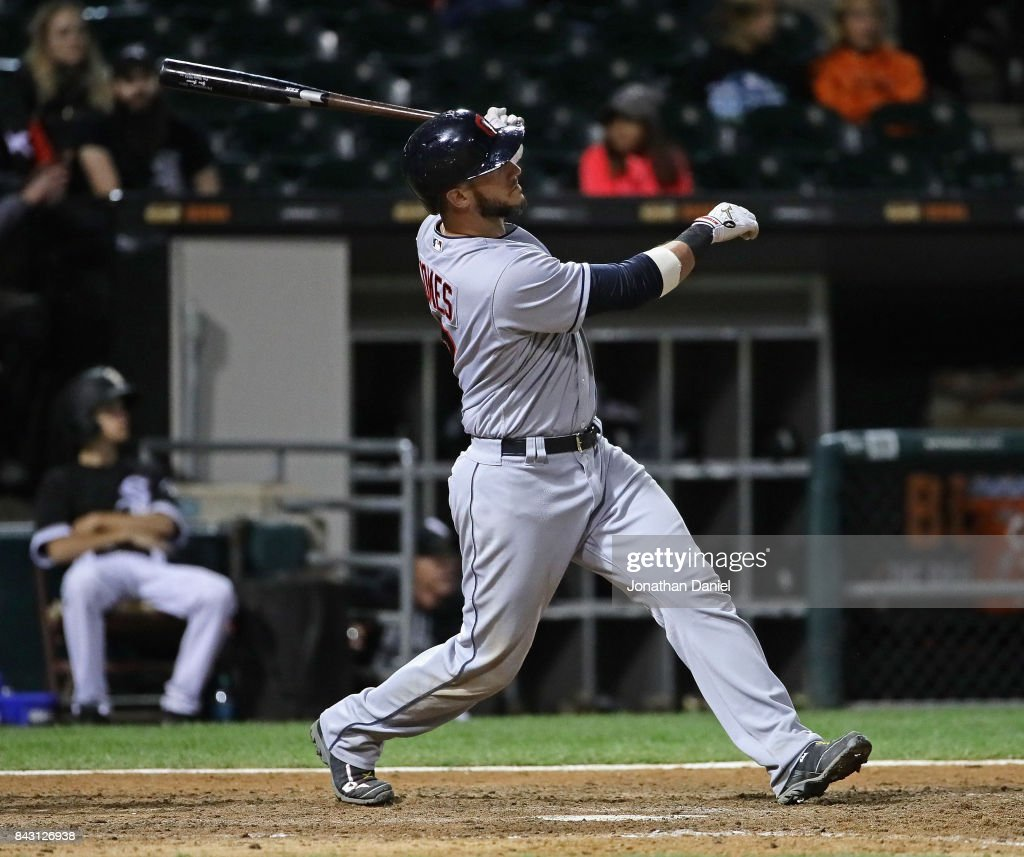 Yan Gomes #7 of the Cleveland Indians hits a three run home run in the 9th inning against the Chicago White Sox at Guaranteed Rate Field on September 5, 2017 in Chicago, Illinois. The Indians defeated the White Sox 9-4.