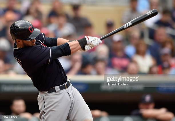 Yan Gomes of the Cleveland Indians hits a threerun home run against the Minnesota Twins during the eighth inning in game one of a doubleheader on...