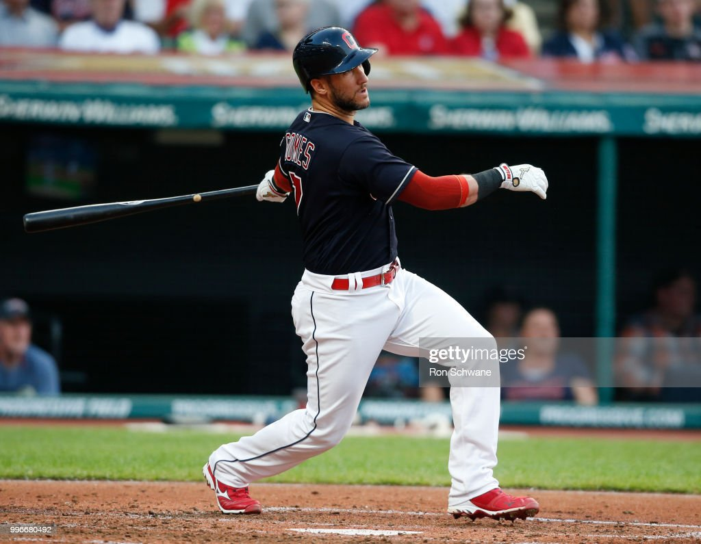 Yan Gomes #7 of the Cleveland Indians hits a two run single off starting pitcher Tyler Mahle #30 of the Cincinnati Reds during the third inning at Progressive Field on July 11, 2018 in Cleveland, Ohio.The Indians defeated the Reds 19-4.