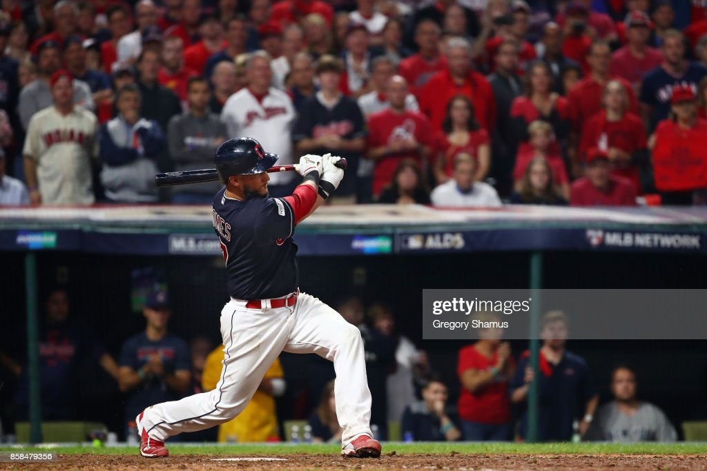 Yan Gomes #7 of the Cleveland Indians hits an RBI single scoring Austin Jackson #26 to win the game 9 to 8 in the 13th inning during game two of the American League Division Series at Progressive Field on October 6, 2017 in Cleveland, Ohio.