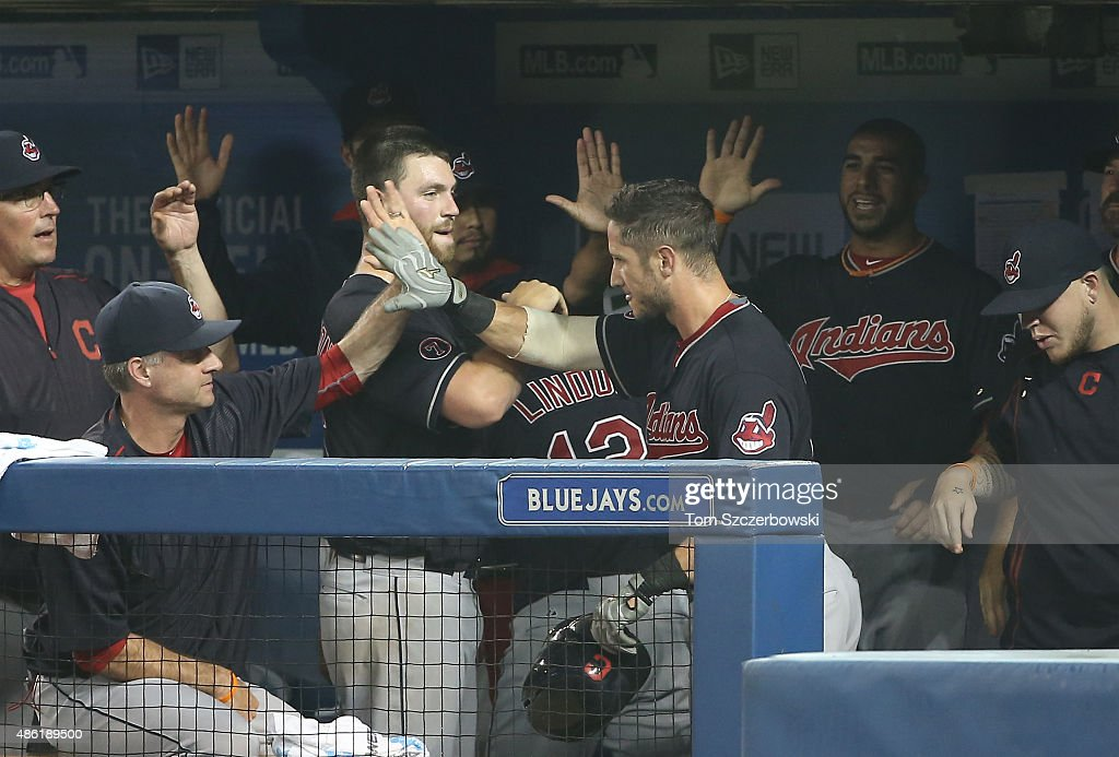 Yan Gomes #10 of the Cleveland Indians is congratulated after hitting a solo home run in the seventh inning during MLB game action against the Toronto Blue Jays on September 1, 2015 at Rogers Centre in Toronto, Ontario, Canada.