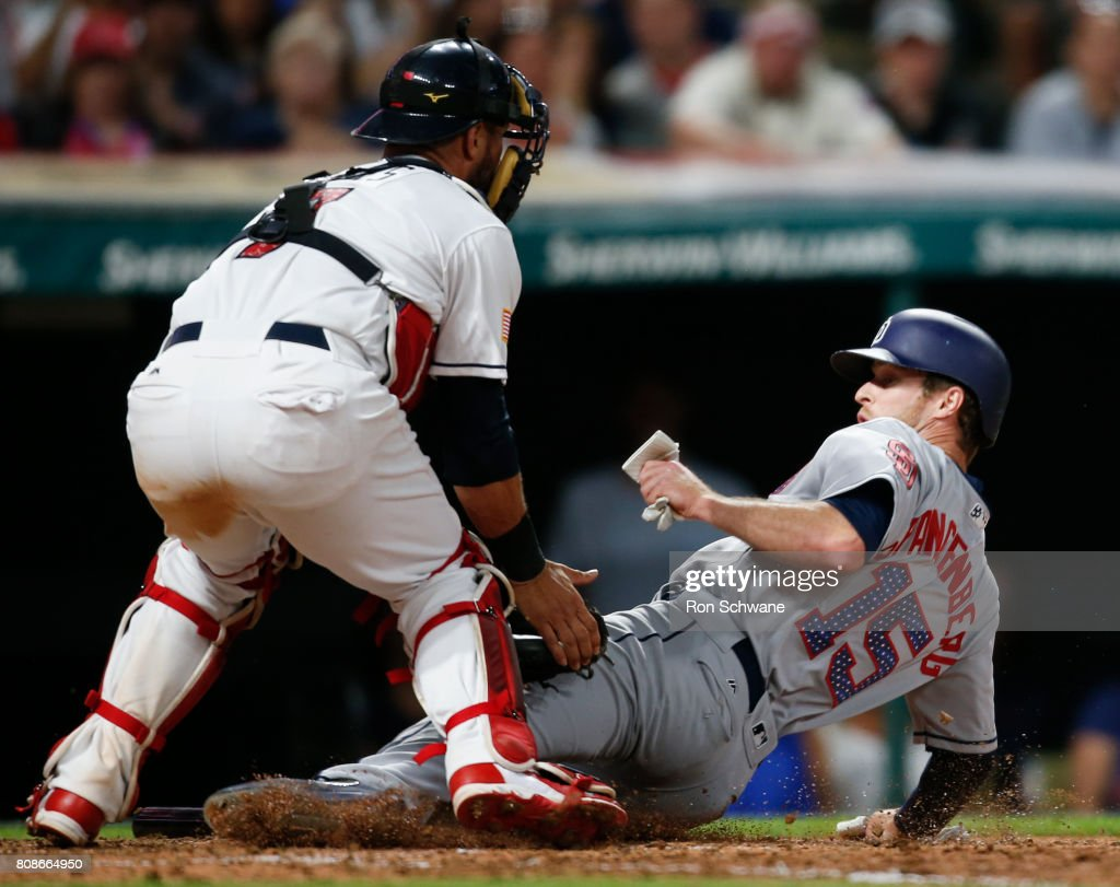 Yan Gomes #7 of the Cleveland Indians tags out Cory Spangenberg #15 of the San Diego Padres at home plate trying to score on a a single by Manuel Margot during the eighth inning at Progressive Field on July 4, 2017 in Cleveland, Ohio.