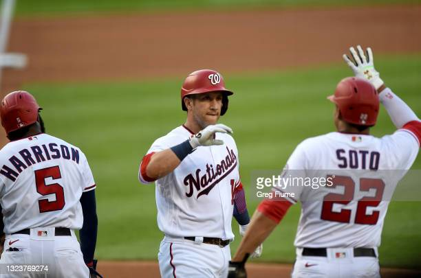 Yan Gomes of the Washington Nationals celebrates with Josh Harrison and Juan Soto after hitting a Grand Slam in the first inning against the...