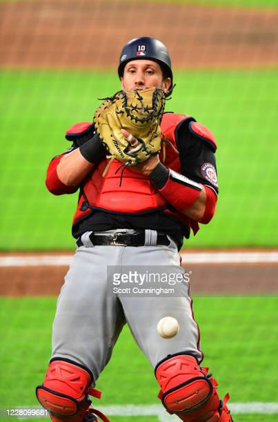 Yan Gomes of the Washington Nationals is unable to hold on to a pop fly foul ball against the Atlanta Braves in the ninth inning at Truist Park on...