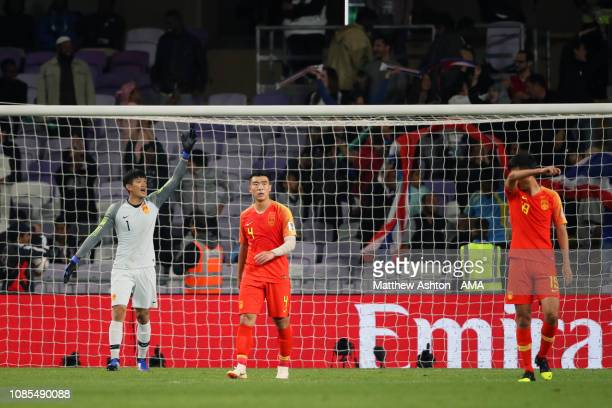 Yan Junling of China and his team-mates react after Supachai Chaided of Thailand scored the first goal to make it 1-0 during the AFC Asian Cup round...