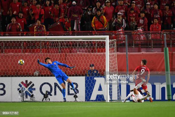 Yan Junling of Shanghai SIPG dives in vain as collision of Yuma Suzuki of Kashima Antlers and Yu Hai of Shanghai SIPG triggers the own goal during...