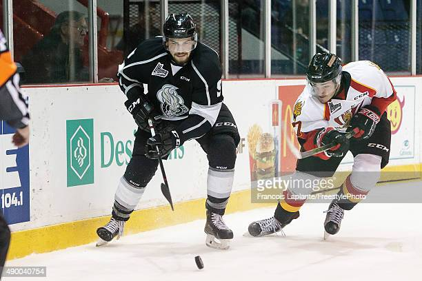 Yan Pavel Laplante of the Gatineau Olympiques battles for the puck against Matthieu Desautels of the Baie Comeau Drakkar on September 25 2015 at...