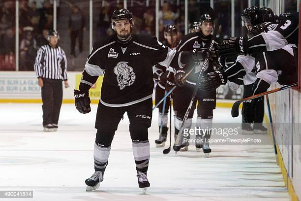 Yan Pavel Laplante of the Gatineau Olympiques celebrates his third goal of the game at the bench with teammates against the Baie Comeau Drakkar on...
